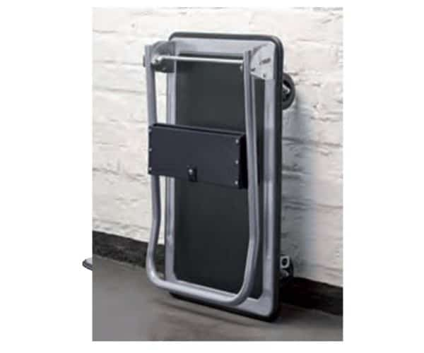 Platform cart K2-300kg with folded handle and mounted tool pocket. Vertically supported on a wall.