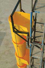 The picture shows a real system of building waste chutes attached to a metal frame.