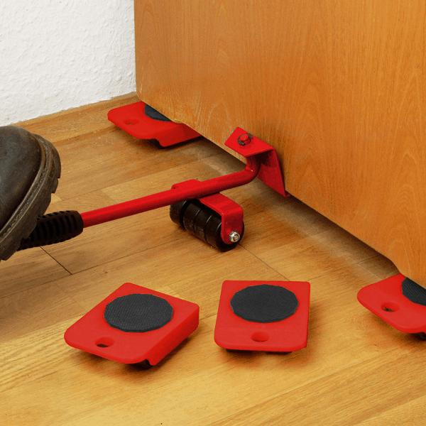 Комплект за пренасяне на мебели. След повдигане и поставяне на подложките обекта може да се премести.